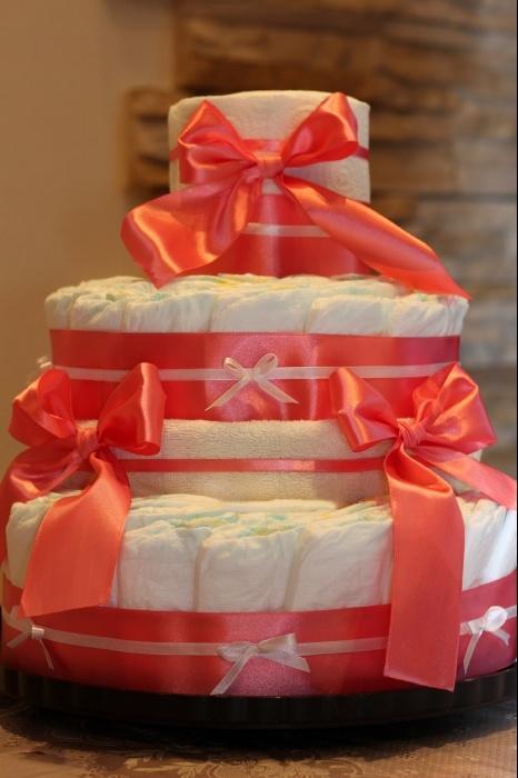 Торт № 2 Памперсы 90-100 шт. Пеленка фланель - 1 шт. Полотенце махровое - 1 шт. Ленты, упаковка.