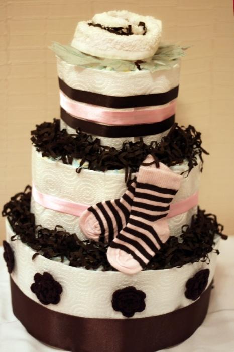 Торт № 5 Пампресы - 80-90 шт. Полотенце махровое - 1 шт. Носочки - 1 пара Отделка - ленты, цветы вязаные, упаковка.