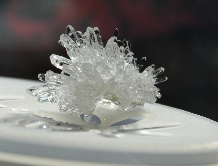 А вот это кристалик, выращивается на подвешанном в воде камушке или кусочке выращенного ранее кристалла. На солнце переливается как сваровски:)