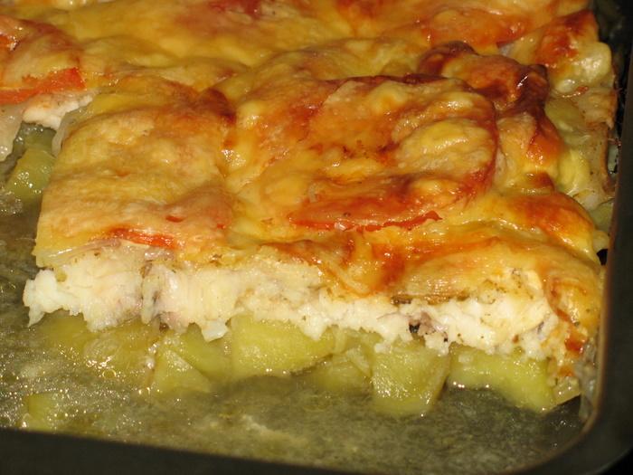 [b]***Морской язык с картошкой и помидорами***[/b][br]Рецепт взят с сайта Кулинар.[br][br]Филе морского языка (или другая белая рыба) 1150гр[br] картофель полуотварной 10-15 шт[br] помидорка средняя 1 шт[br] лук 2 шт[br] сыр твердых сортов 200гр[br] майонез, соль, хмели сунели, сок лимона, чеснок и немного слив.масла.[br][br]Филе языка солим, поливаем соком лимона и обсыпаем хмели сунели. Пусть маринуется пока варится картофель. Лук шинкуем полукольцами и обжариваем в масле. В форму, смазанную немного маслом, укладываем слоями картофель, нарезанный кружочками, лук, филе, помидор кружочками, солим,майонезим немного,добавляем маленькие кусочки сливочного масла между рыбкой, укладываем вплотную квадратики сыра (можно через терку. В разогретую до 200*С духовку отправляем наш морской язык на 30-40 минут до полного румянения сырной корочки. Блюдо готово! Приятного аппетита![br][br]Картофель всетаки нужно отварить до полуготовности, так как рыбка готовится очень быстро. Если же всетаки употребить сырой картофель, то его нужно будет порезать очень тонко, чтобы он успел приготовиться.